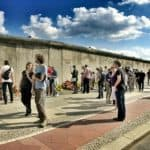The longest remaining stretch of the Berlin Wall is the world's largest open air gallery, attracting millions of visitors from around the world since opening in 1990.